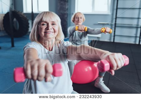 Maintaining A Healthy Lifestyle. Selective Focus On An Excited Woman Looking Into The Camera With A