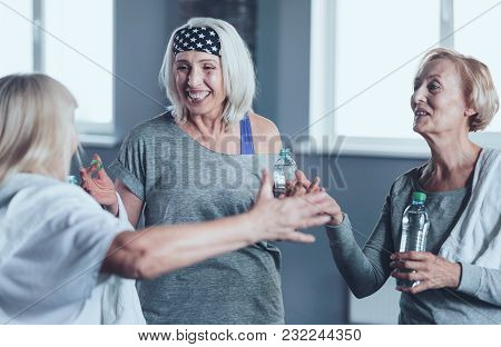We Have To Repeat This. Beaming Elderly Women With Bottle Of Water Cannot Keep Their Emotions Inside