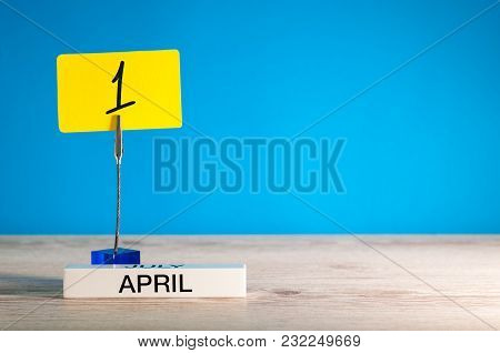 April 1st. Day 1 Of April Month, Calendar On Little Yellow Tag. Spring Time. Fools Day. Empty Space
