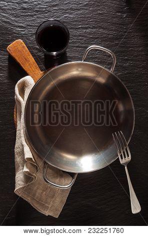 Empty Serving Pan On Slate Black Stone Background
