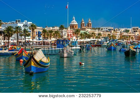 Traditional Eyed Colorful Boats Luzzu In The Harbor Of Mediterranean Fishing Village Marsaxlokk, Mal