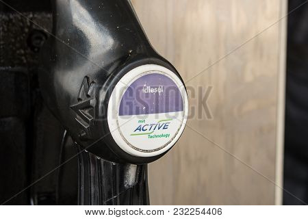 Ach,austria-mar 20,2018: Close Up View Of A Nozzle Hanging At A Gas Pump For Diesel Fuel