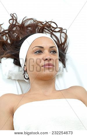 Young Beautiful Woman At Bed In Beauty Clinic