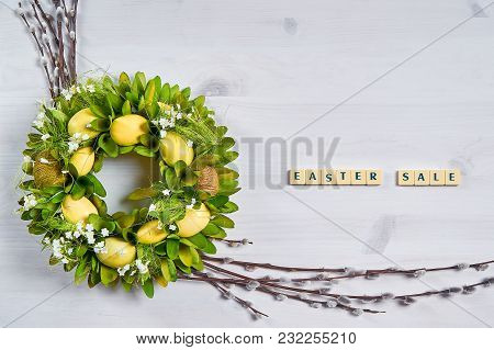 Easter Background With Eggs, Catkins And The Text Easter Sale On A White Wooden Table