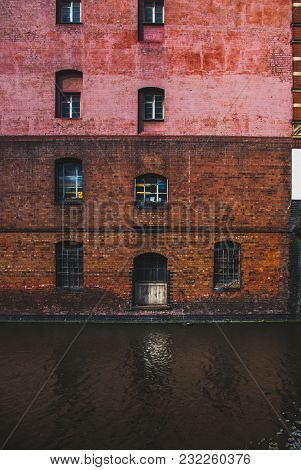 Red Bricked Building Reflection On River Trent