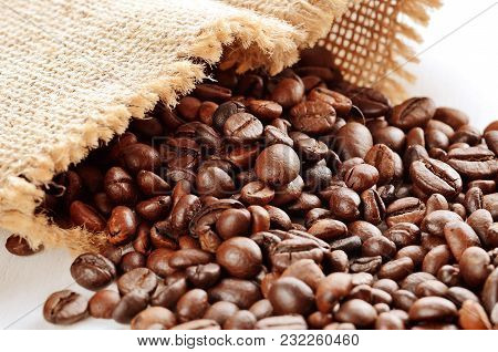 Close-up Of Spilled Coffee Beans From Canvas Sack