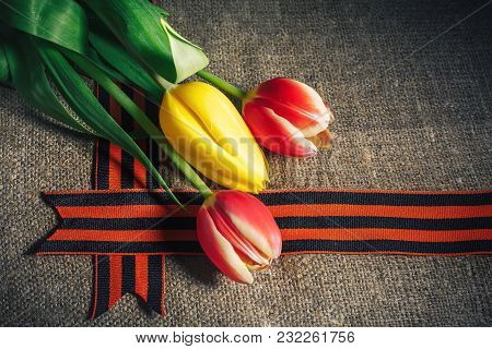 Military Cap With Order Of Great Patriotic War And Tulips Flowers Tied By Saint George Ribbon In Hon