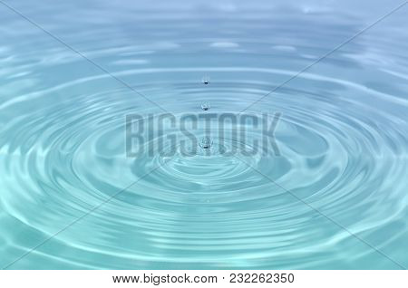 Beautiful Close Up Detail Of A Droplet Of Blue - Turquoise Water