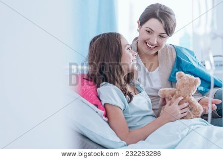Sisters Smiling In Hospital
