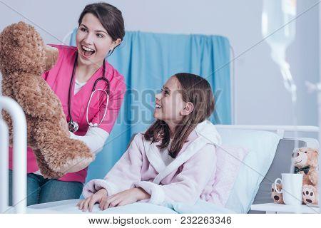Nurse Holding Teddy Bear