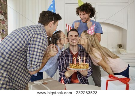 Friends With Cake Celebrating Birthday At A Party In Room.