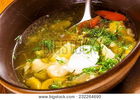 Soup With Different Vegetables And Sour Cream. Close-up