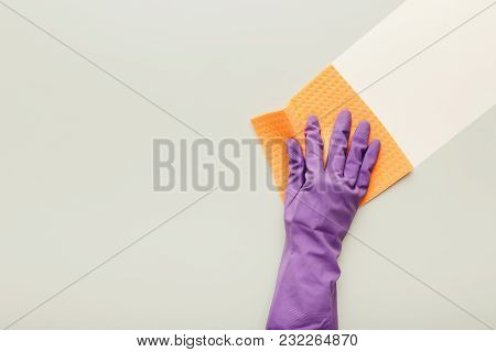 Hand In Protective Rubber Glove With Orange Rag. Woman Washing White Surface With Micro Fiber Cloth,