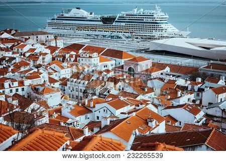 Rooftopspanorama Of The Oldest District Alfama In Lisbon. Cruise Boat On The Tagus River. Lisbon Lis