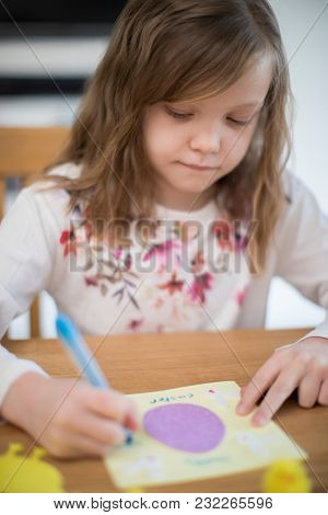 Girl At Home Designing Home Made Easter Card