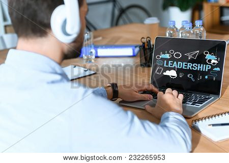 Happy Woman In Shirt Sitting On Chair With Legs On Table Against Laptop While Speaking On Phone, Ins