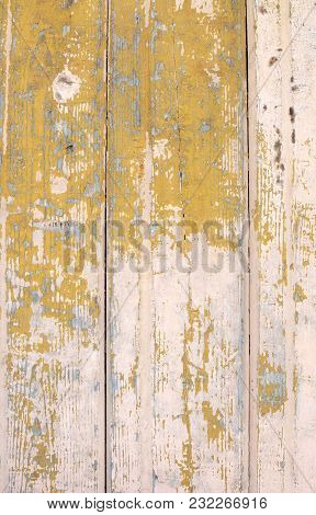 Texture Of Old Beige Boards With Flaking Gold Paint
