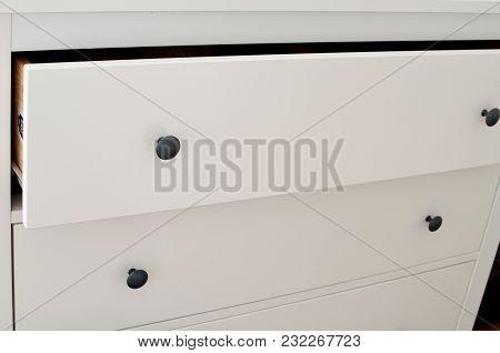 Detail Of Drawers Of Modern White Laminate Dresser