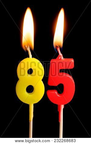 Burning Candles In The Form Of 85 (eighty Five) Figures (numbers, Dates) For Cake Isolated On Black