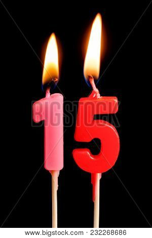 Burning Candles In The Form Of 15 Fifteen Figures (numbers, Dates) For Cake Isolated On Black Backgr