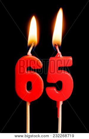 Burning Candles In The Form Of 65 Sixty Five Figures (numbers, Dates) For Cake Isolated On Black Bac