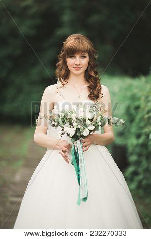 Beautiful Luxury Bride In Elegant White Dress.