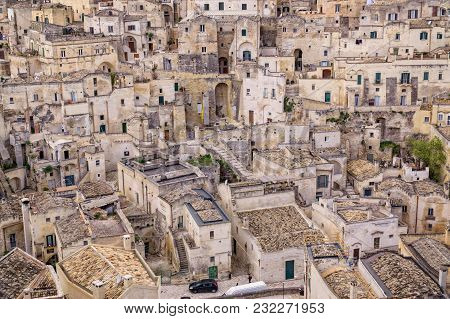 Old Houses And Buildings In The Town Of Matera, Italy, With Old Stone Architecture And Small Cobbles