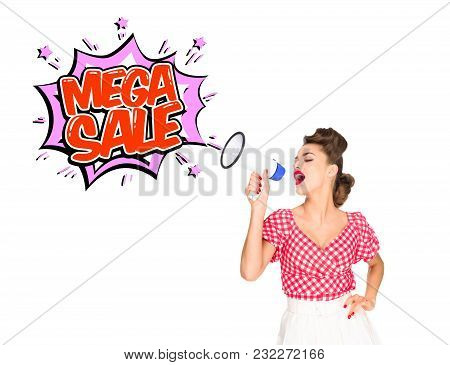 Portrait Of Fashionable Young Woman In Pin Up Style Clothing With Mega Sale Explode Out Of Loudspeak