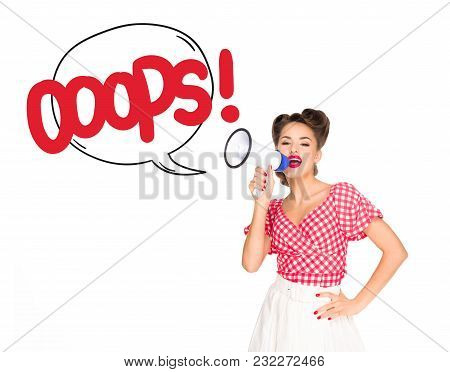 Portrait Of Fashionable Young Woman In Pin Up Style Clothing With Oops Speech Bubble Out Of Loudspea