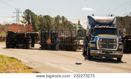 March 10, 2017: Carrboro Nc Usa-logging Truck Overturned On Highway With Logs
