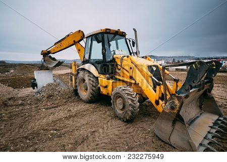 Close Up Details Of Massive Working Machinery, Industrial Backhoe Loader With Excavator On Construct