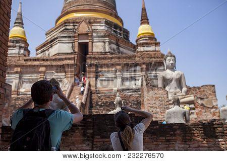 Ayutthaya Thailand - Sep14,2017 : Unidentified Tourist Taking A Photograph In Wat Yai Chaimongkol Mo