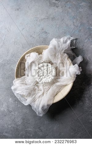 Fresh Homemade Cottage Cheese In Cheesecloth Served In Ceramic Bowl Over Grey Texture Background. To