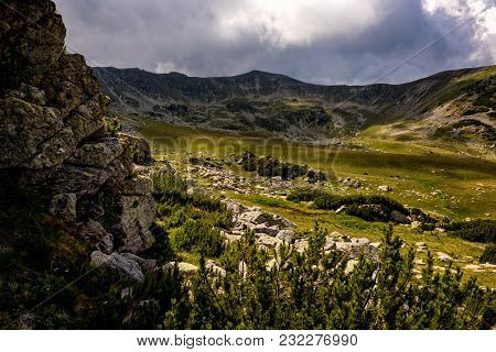 Idyllic Valley In The Romanian Carpathians With A Sheep Herd Grazing