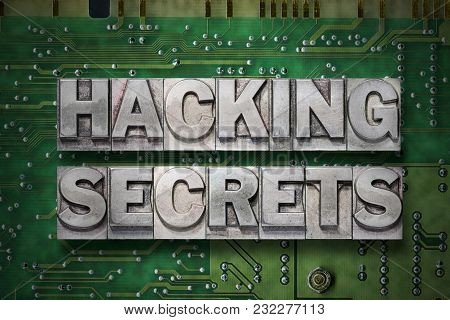 Hacking Secrets Phrase Made From Metallic Letterpress Blocks On The Pc Board Background