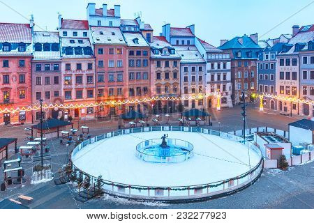 Old Town Market Place With Statue Of Syrenka, Mermaid Of Warsaw, In The Center Of The Ice Rink And C