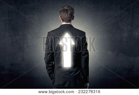 Young businessman standing and thinking about which direction to choose