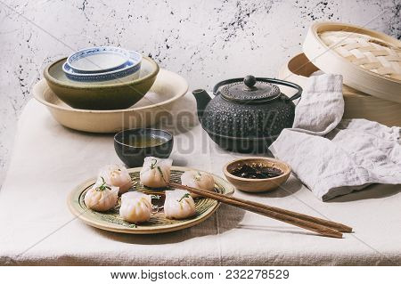 Asian Steam Potstickers Dumplings Stuffed By Shrimps, Served On Ceramic Plate With Soy Sesame Sauce,