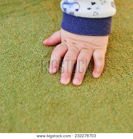 Beautiful Baby One Hand On Green Carpet
