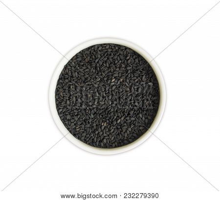 Black Sesame On White Background. Top View. Black Sesame In A Bowl Isolated On White Background. Ses