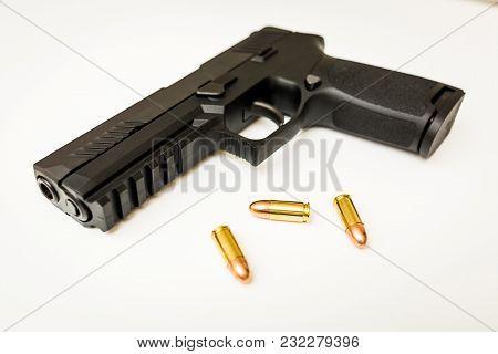 Handgun With Ammo Rounds And Smoke