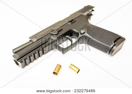 Unloaded Handgun With Ammo Rounds White Background