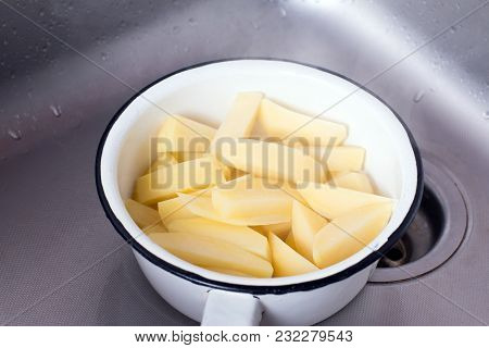 Draining Boiled Potato Slices In Colander. Potato Slices In A Colander