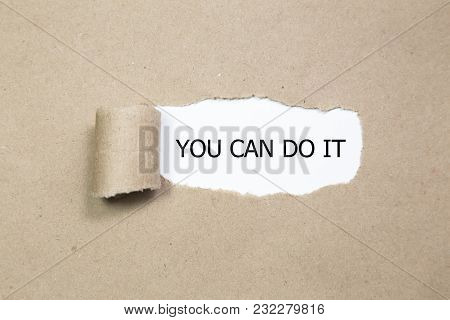 Torn Brown Paper With You Can Do It Words. Buniss Concept
