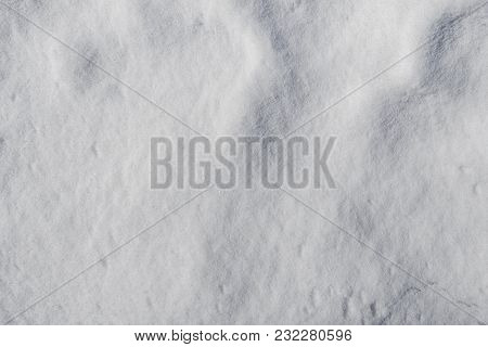 Snowy Snowdrift In Spring Sunlight. Beautiful Shiny Background For Design Ideas. Abstract Snow Backg