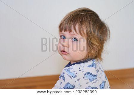 Portrait Of Cute Adorable Blonde Caucasian Baby Child Girl Sitting On Floor Indoor, Fairy Tale Sun L