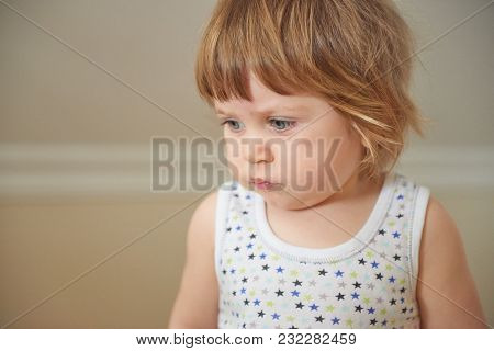 Portrait Of Cute Adorable Blonde Caucasian Smiling Baby Child Girl Sitting On Floor Indoor, Fairy Ta