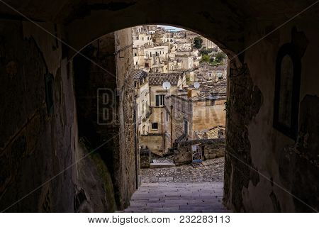 The Old Stone Houses Of Matera, Italy, Seen Through An Archway Tunnel