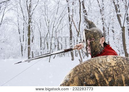 Spartan Warrior Is Hunting In Winter Forest.