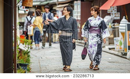 Kyoto, Japan - June 10: Unidentified Japanese Couple Dress In Traditional Clothes And Take Selfie Ph